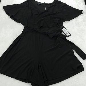 Bebe size 4 black romper with slit sleeves, NWT!